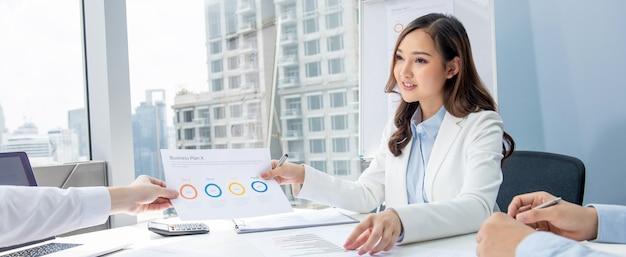 Asian businesswoman having annual meeting in office Premium Photo