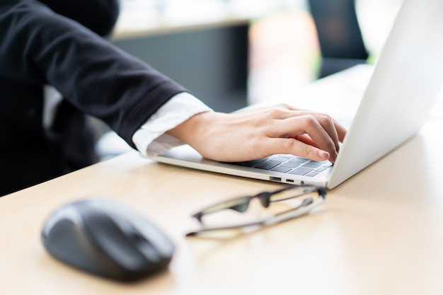 Asian businesswoman in office working hard. office syndrome and workaholic in office people concept.  hard working businesswoman in office having a health problem. Premium Photo