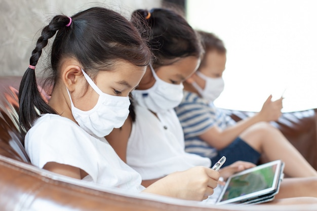 Asian children boy and girls wearing protection mask playing on ...