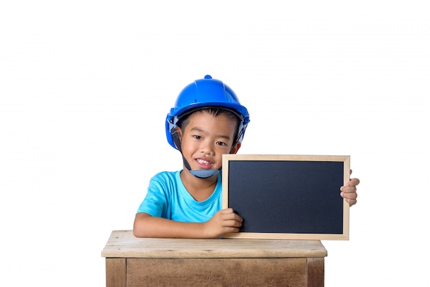 Asian children wearing safety helmet and smiling with chalkboard isolated on white background. kids and education concept Premium Photo