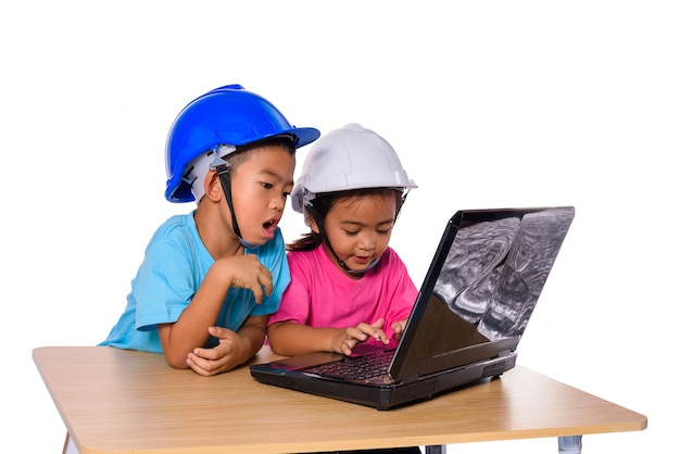 Asian children wearing safety helmet and thinking planer isolated on white background. kids and education concept Premium Photo