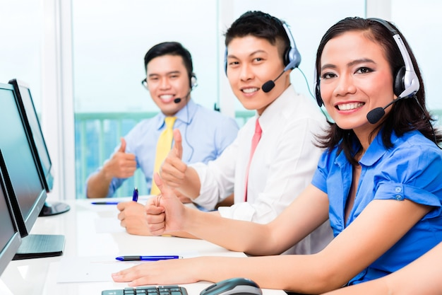 Asian chinese call center agent team on phone Premium Photo