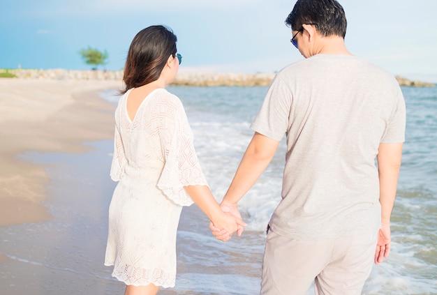 Asian couple on beach Free Photo