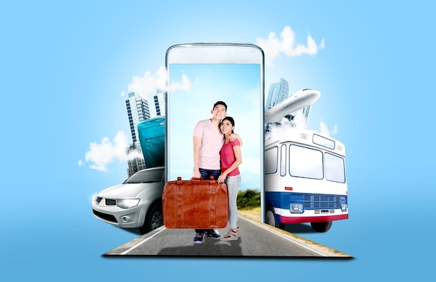Asian couple carrying suitcase bag standing on the street Premium Photo