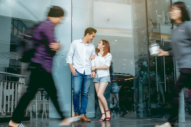 Asian couple in city. Premium Photo