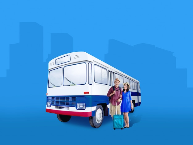 Asian couple in hat with suitcase bag and backpack standing beside the bus Premium Photo