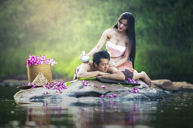 Asian couple having massage and spa salon beauty treatment concept. she is very happy Premium Photo