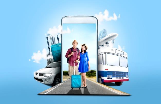 Азиатская пара в шляпе с чемоданом и рюкзаком, стоя на улице Premium Фотографии