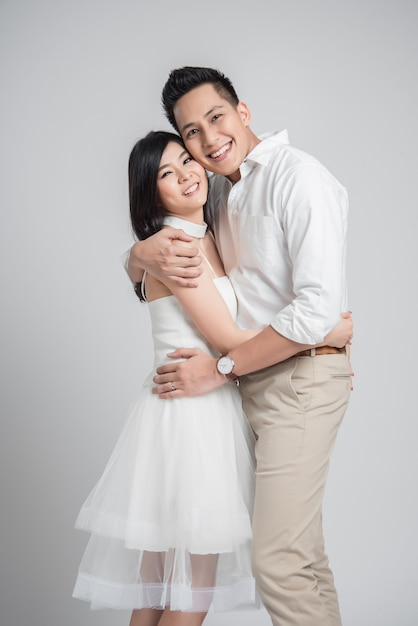 Asian couple in love embracing on white background Premium Photo