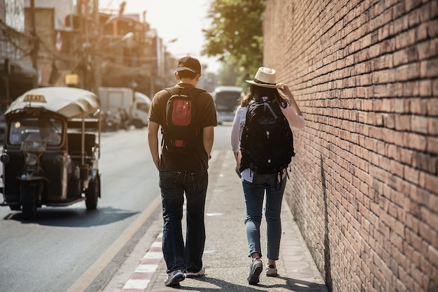 Asian couple tourist crossing the road Free Photo