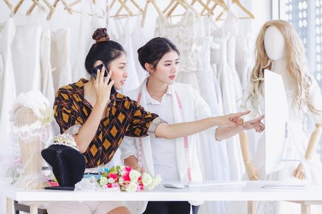 Asian designer working in wedding fashion store shop Premium Photo