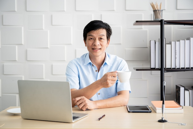 Asian elder businessman' in the office in the morning Premium Photo
