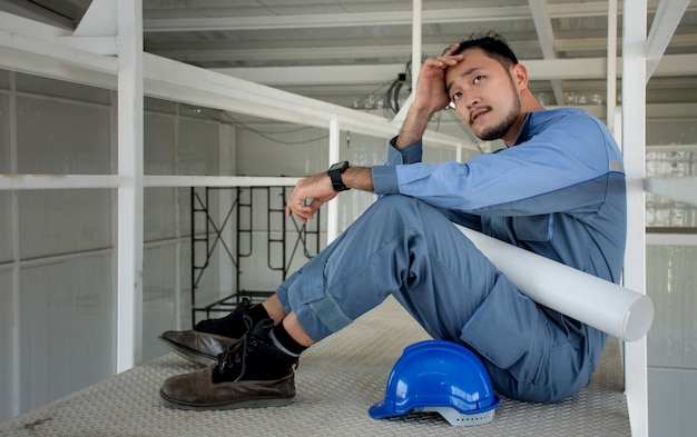 Asian engineers suffering stress fail to make mistakes in their work and business sit down Premium Photo