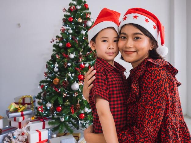 Asian family celebrating christmas in house Premium Photo
