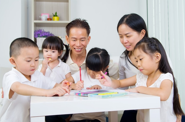 Asian family doing school homework at living room Premium Photo