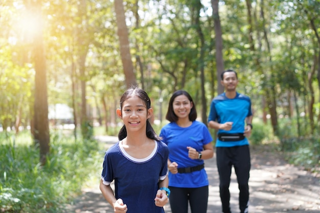 Premium Photo   Asian family exercising and jogging together at the park