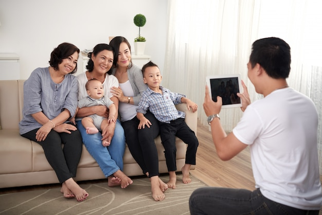 Asian family posing for portrait Free Photo