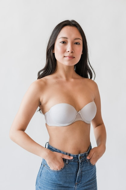 Asian female in bra with hands in pockets Free Photo