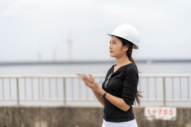 Asian female engineer checks job Premium Photo