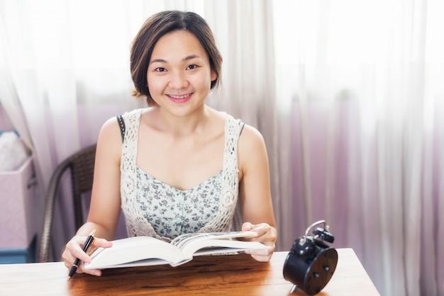 Asian female student read book for final exam Premium Photo