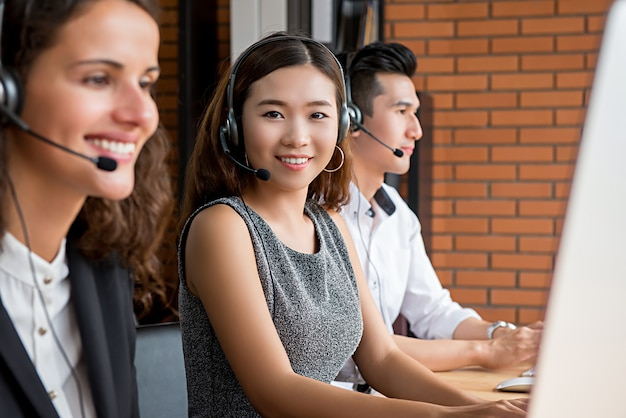 Asian female telemarketing customer service agent working in call center Premium Photo