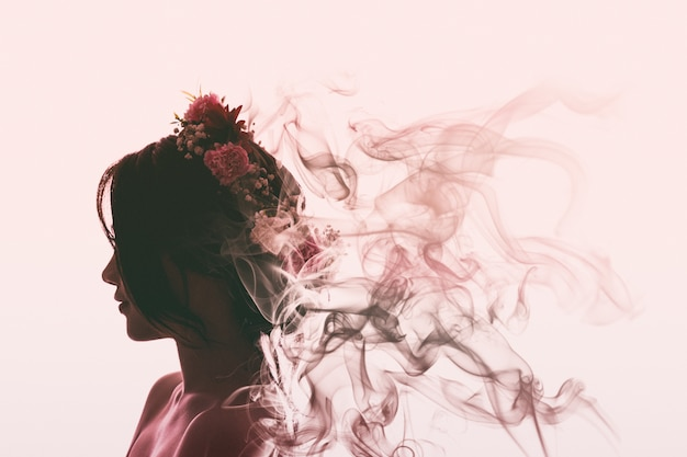 Asian girl is beautiful and charming with flowers crown. she is evaporating into perfume smoke. flare light style. Premium Photo