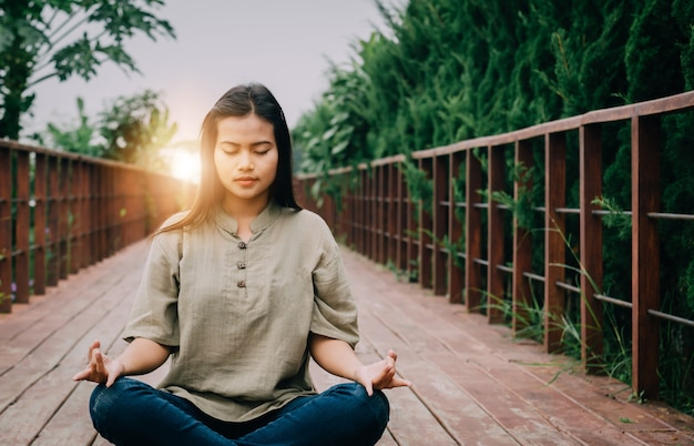 Premium Photo   Asian girl is meditating.