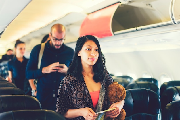 Asian girl traveling by airplane Premium Photo