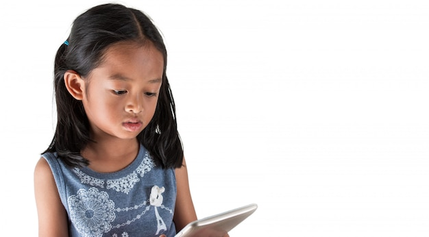 Asian girls are using tablet viewing entertainment content, used for warning children about technology. Premium Photo