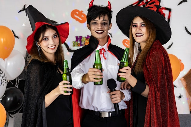 Asian group of friend celebrate and cheers halloween party. Premium Photo