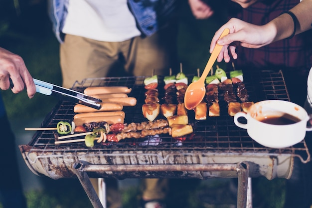 Asian group of friends having outdoor garden barbecue Premium Photo