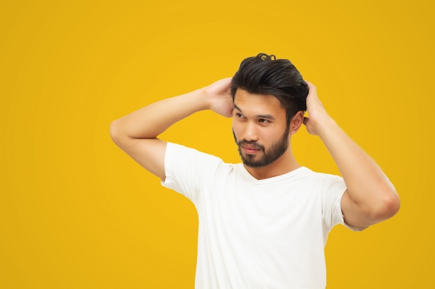 Asian handsome man with a mustache, smiling and laughing isolated on yellow background Premium Photo