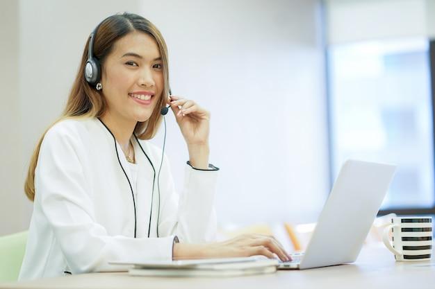Asian help desk woman working Premium Photo