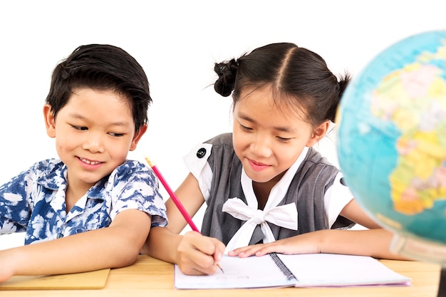 Asian kids are happily studying with blurred globe over white background Free Photo