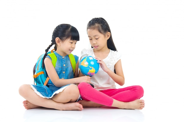 Asian kids looking at the globe Premium Photo