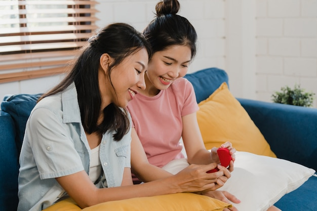 Asian lesbian lgbtq women couple propose at home Free Photo