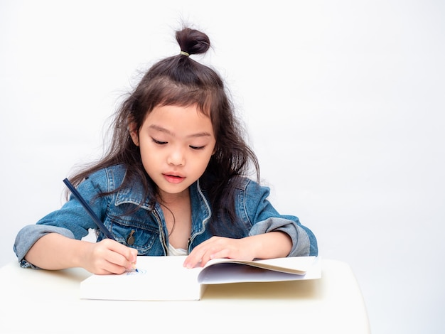 Asian Little Cute Girl Use Color Pencil And Drawing Cartoon On