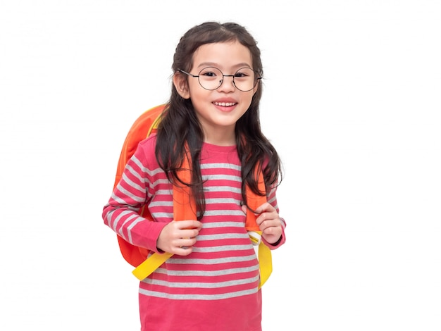 Asian little cute girl wearing glasses and student backpack. student lovely kid with preparing back to school. Premium Photo