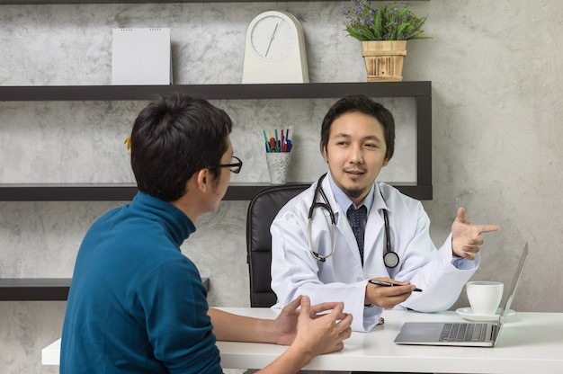 Premium Photo | Asian male doctor discussing diagnosis with patient about  his health