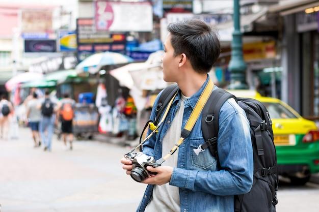 Asian male tourist backpacker traveling in khao san road