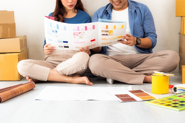 Asian man ad woman design and thinking to decorate home Premium Photo