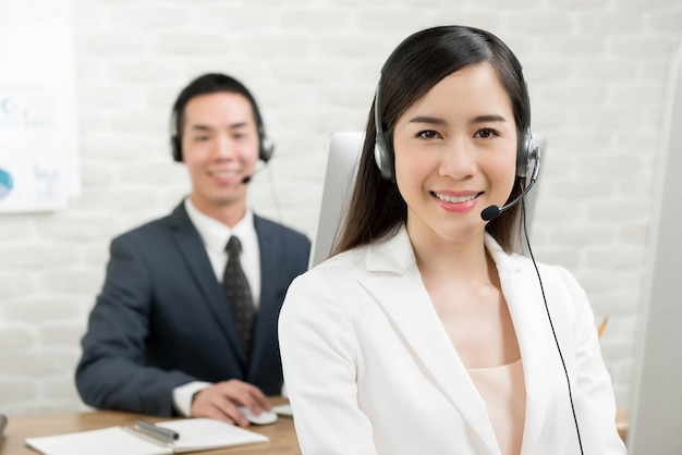 Asian man and asian woman working in a call center Premium Photo