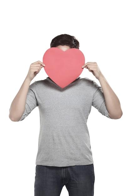 Asian man holding red heart Premium Photo