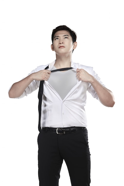 Asian man open his shirt isolated over white background Premium Photo