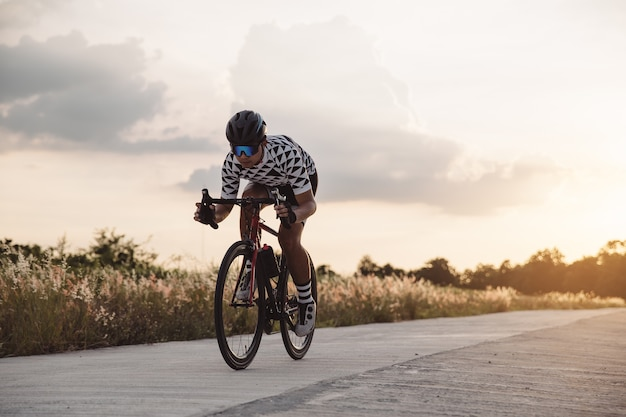 Asian man ride a bicycle at sun set  the image of cyclist in
