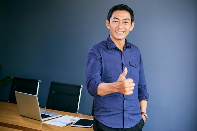 Asian man saying good job Free Photo