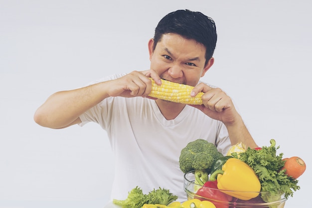 Asian man showing enjoy expression of fresh colorful vegetables Free Photo