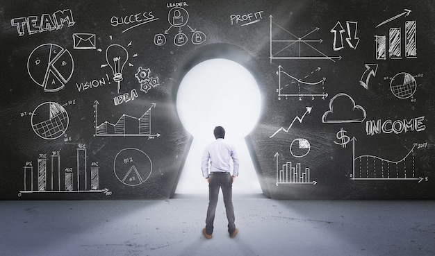 Asian man standing in front of  keyhole with drawing business concept Premium Photo