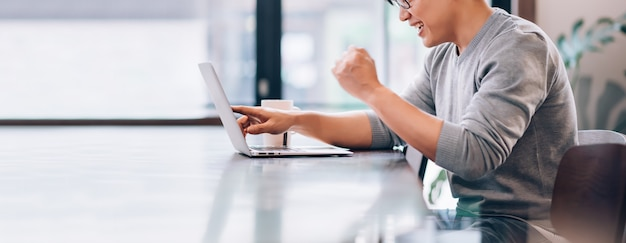 Asian man using laptop computer connect with high speed internet 5g wireless connection technology work from home Premium Photo