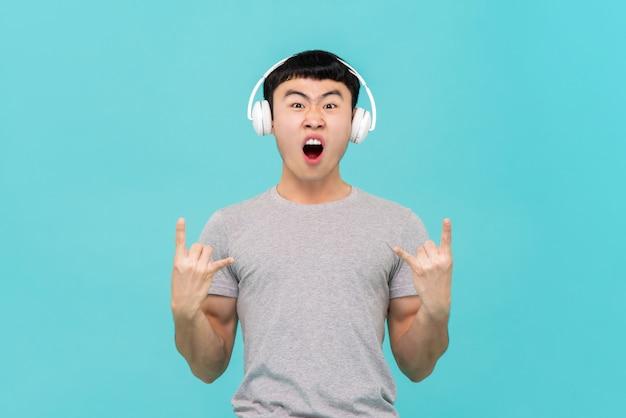 Asian man wearing headphone listening to music Premium Photo